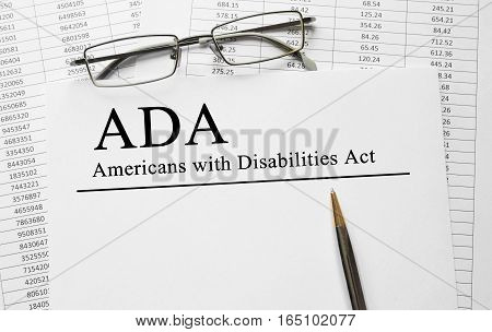 Paper with Americans with Disabilities Act ADA on a table