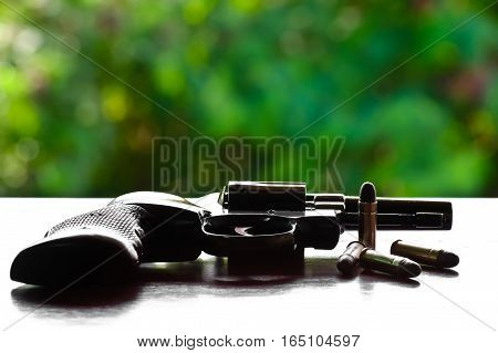 Guns, ammunition and hand on the table