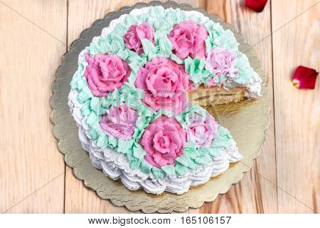 Delicious creamy cake basket of roses on  wooden table