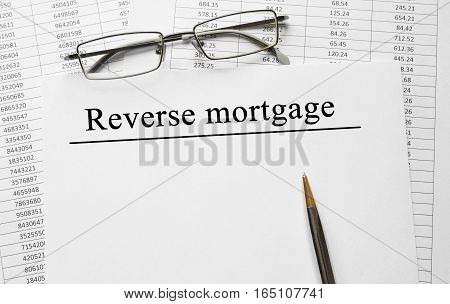 Paper With Reverse Mortgage On A Table