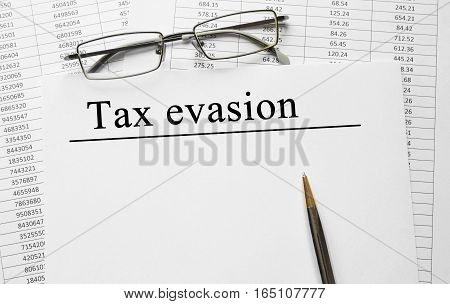 Paper With Tax Evasion On A Table