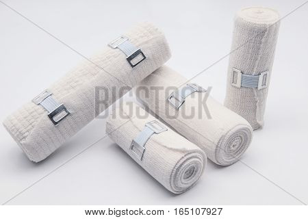 Elastic bandage with clips at white background