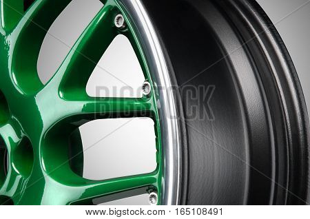 Green spotr alloy rim  at grey background