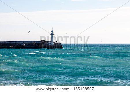Yalta. Crimea. Lighthouse In The Bay Near The Seaport.