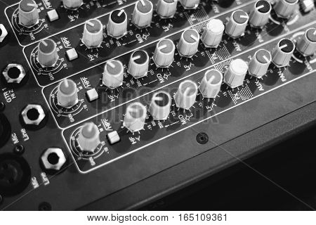 background electronic mixing console instrument media technology black and white