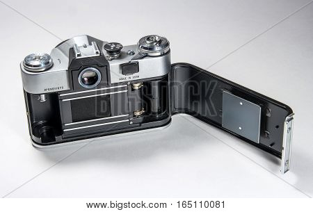 Gatchina, Russia - January 14, 2017: The old Soviet film camera Zenit. Photographed on a bright background. The camera shows the rear to open the back cover.