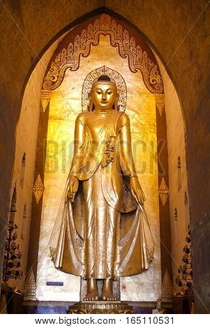 Golden Buddha statue on the temple of Ananda at Bagan on Myanmar