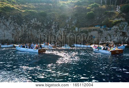 Capri Italy - October 20 2008: Tourists on the boats waithing to enter in the Grotta Azzurra sea cave