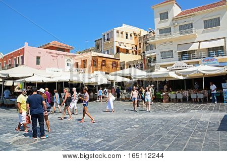 CHANIA, CRETE - SEPTEMBER 16, 2016 - Tourists and shops in Pl El Venizelou square Chania Crete Greece Europe, September 16, 2016.