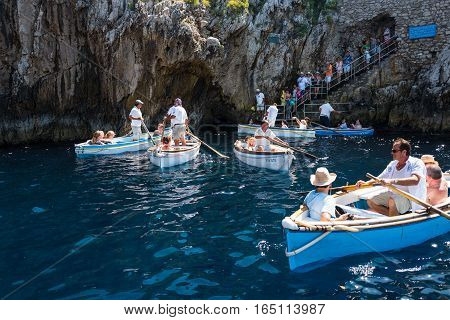 Capri Italy - August 5 2015: Boats with tourists waiting to get into the Blue Grotto
