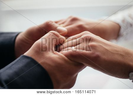Men's hands hold the female symbol of trust and family