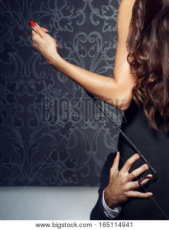 Rich businessman grip woman ass at night bdsm