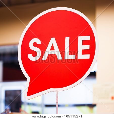 red Sale signs in shop, time for shopping