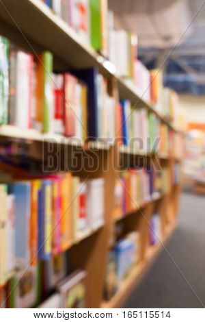 Blurred bookshelves with colorful books. no focus