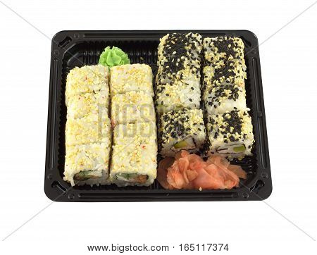 Portions of sushi rolls in black plastic container isolated on white closeup