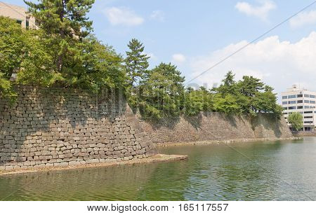 FUKUI JAPAN - AUGUST 02 2016: Moat and stone walls of Fukui castle in Fukui Japan. Castle was founded in 1601 by Yuki Hideyasu and dismantled in 19th c.