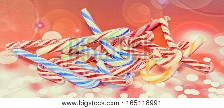 Colored Christmas Candies, Lollypops, Sweets, Close Up, Red Bokeh Background.