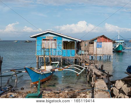 Fishing vessels and fishermen's homes in Tinoto a fishing village in Maasim the province of Sarangani on Mindanao the southernmost island of The Philippines.