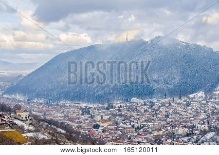 BRASOV ROMANIA - MARCH 19 2015 - The Cityscape of Brasov City in winter time cloudy day