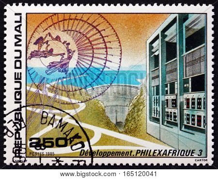MALI - CIRCA 1985: a stamp printed in Mali shows Road Dam and Computers circa 1985