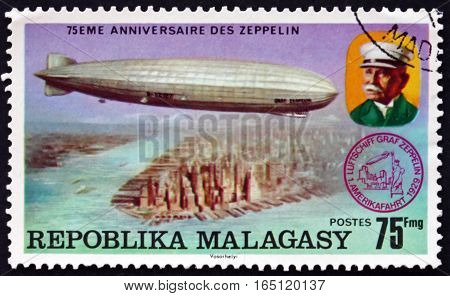 MALAGASY - CIRCA 1975: a stamp printed in Malagasy Madagascar shows Count Zeppelin and LZ-127 over New York City 75th Anniversary of the Zeppelin circa 1975