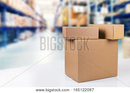blank cardboard boxes on the table in warehouse with copy space