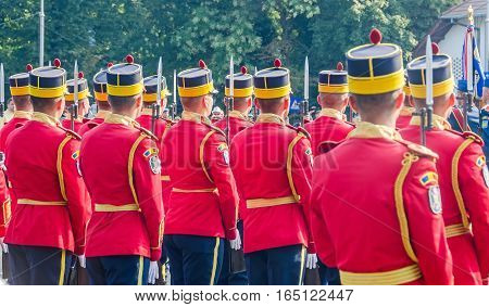 Bucharest, Romania - July 19, 2015. The Aviation Day Near Aviators Statue. Soldiers Dressed In Speci