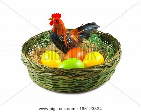 Easter Eggs and Chicken in basket on white background