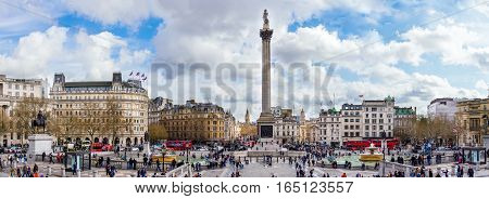 London, UK - April 6, 2016: Tourists visiting Trafalgar square and the National Gallery in the afternoon