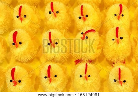 Easter, artificial chicks on a yellow background
