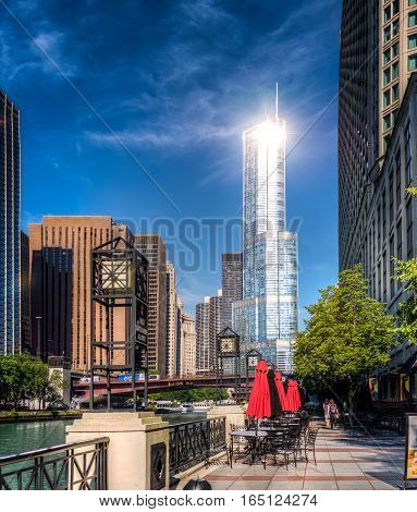 Chicago, US - July 17, 2016: Intense sun reflection from Trump Tower as seen from river walk at downtown Chicago