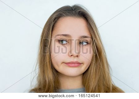 Portrait of beautiful teenager girl emotional posing on white background isolated. Fatigue, boredom