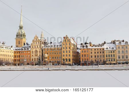 STOCKHOLM - JAN 08 2017: Old architecture in old town in stockholm a sunny winter day ice on the sea. January 08 2017 in Stockholm Sweden