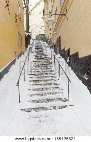 Steep snowy stairs a sunny winter day in central Stockholm Sweden