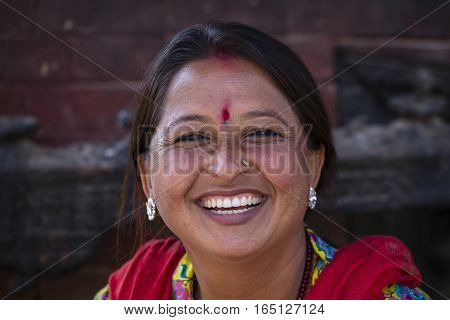 KATHMANDU NEPAL - OCTOBER 25 2016 : Portrait old women in traditional dress in street Kathmandu Nepal