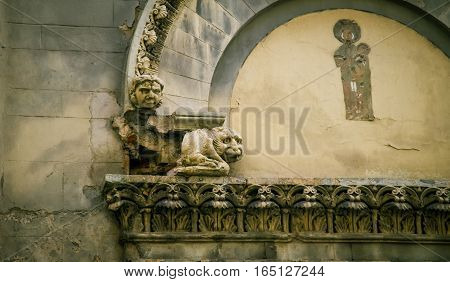 Religious fresco and statue with a railing