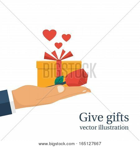 Give gifts. Isolated on white background. Gift box with ribbon and red rose hold in hand man. Vector illustration flat design. Romantic surprise for Valentine's Day. Congratulation. Love greetings.