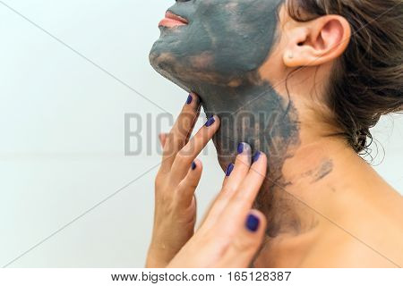 She Spreads The Clay On His Neck