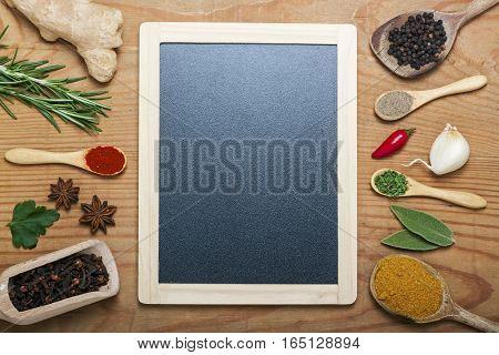 A chalkboard menu on a wooden background