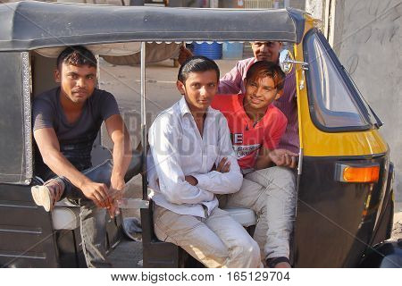 BHUJ, GUJARAT, INDIA - DECEMBER 20, 2013: Portrait of Rickshaw drivers