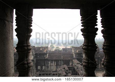 Angkor Wat asian temple ruins between pillars