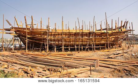 MANDVI, GUJARAT, INDIA: Traditional wooden Dhow building poster
