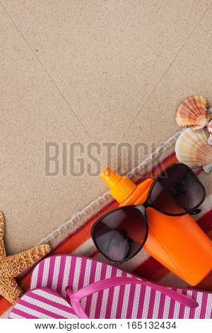 Beach accessories for the beach lying on the sand with place for your text