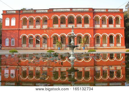 GONDAL, GUJARAT, INDIA - DECEMBER 24, 2013: Reflections of the Orchard Palace Hotel
