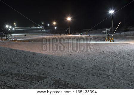 Ski with rope tow at night. Night skiing. Zuberec Ski Park. Slovakia. Western Tatras.