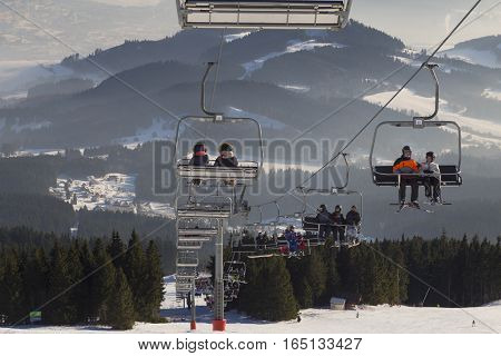 January 1 2017 . New Year. Ski park Kubinska Hola Slovakia. District Dolny Kubin Orava. Bright frosty holiday. People skiing and go on chair lift. Theme of sports family healthy lifestyle.