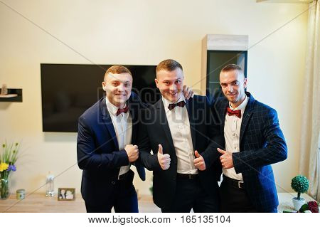 Groom With Best Mans At His Wedding Day On Room.
