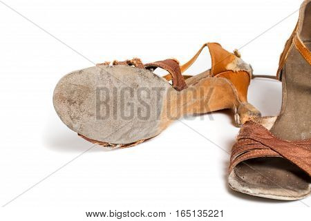 closeup shot of pair of worn-out latin ballroom dance shoe - isolated