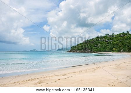 Shoreline of a tropical island in the Seychelles and view of the Ocean