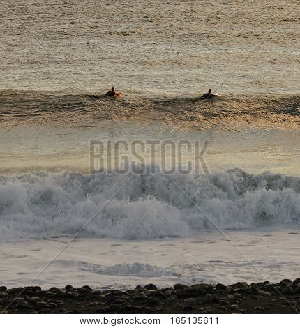 detail of two surfer in Genova Voltri Italy
